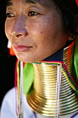 Closeup of a Longneck woman  Approximately 300 Burmese refugees in Thailand are members of the indigenous group known as the Longnecks  The largest of the three villages where the Longnecks live is called Nai Soi, located near Mae Hong Son City  Longnecks