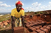 In Burundi, many new schools and houses are currently buing built after peace has come  Half a million Burundi people fled during the war 2003-2006 to Tanzania but almost all returned finding their country in pieces  The buildings are made from local made