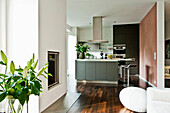 Open living area with kitchen and fireplace, Hamburg, Germany