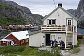 People enjoy Afternoon Coffee outside Bakery, Nusfjord, Flakstadoy, Lofoten, Nordland, Norway, Europe