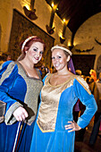Young women perform at Bunratty Castle Medieval Banquet, County Clare, Ireland