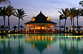 Sunset at pool bar of the holiday resort Le Telfair, Bel Ombre, Mauritius