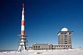 Transmission Mast, and weather station in winter, Brocken mountain, Hochharz National Park, Sachsen-Anhalt, Germany