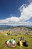 romanian folk music musician performing on folk music contest, visitors listening to performance  Targul de Fete de pe Muntele Gaina translated: Maidens Fair on the mountain Gaina is a traditional transsylvanian festival, where young people met, to find p