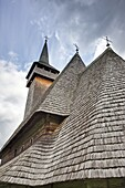 The wooden church biserica de lemn of Botiza, maramures, Romania is listed as the UNESCO World heritage  It was built in 1694 completely from wood and is an example of the traditional crafts in maramures  Europe, Eastern Europe, Romania, Maramures, June 2