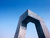 Exterior of new headquarters for Chincese Central Television or CCTV under construction in Beijing China, aarchitect Rem Koolhaas