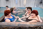 Group of babushkas enjoying a soak in natural hot spring baths at Ozerki near city of Petropavlovsk-Kamchatsky in Kamchatka in Russian Far East