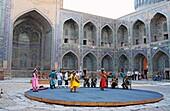 Uzbek folk show in the yard of Shyr Dor Madrasah, Registan Square, Samarkand, Uzbekistan
