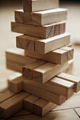 A pile of balancing wooden blocks  Low depth of field, focus not on front of block