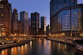 Chicago River and downtown buildings at dusk