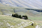 House and road Monti Sibellini National Park Umbria Italy