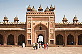 Visitors and Shahi Darwaza Gate, Jama Masjid Mosque complex, Fatehpur Sikri, near Agra, Uttar Pradesh, India