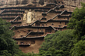 Architecture, Asia, Buddhism, Carved, China, Color, Colour, Daytime, exterior, Faith, Gansu, Grotto, Grottoes, Grottos, Horizontal, Kansu, Maijishan, Mountain, Mountains, outdoor, outdoors, outside, People´s Republic of China, PRC, Religion, Scale, Sculpt