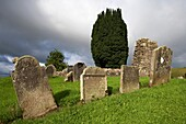18th century irish gravestones next to the ruins of St Kierans errigal keerogue church county tyrone