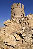 historic adobe watchtower near Nakhal, Nakhl, Hajar al Gharbi Mountains, Batinah Region, Sultanate of Oman, Arabia, Middle East