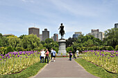 Boston Public Gardens with Giant Allium in bloom, statue of George Washington and city skyline