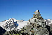 Cairn on the summit of Polleskogel with view towards Wildspitze, Polleskogel, Oetztal mountain range, Tyrol, Austria
