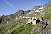 Female mountain hiker near Innsbruck Hut, Habicht, Gschnitz valley, Stubai Alps, Tyrol, Austria
