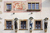 House facade with windows, figures of saints and wall fresco, cloister Muestair, Muestair, UNESCO World Heritage Site Muestair, Engadin, Grisons, Switzerland