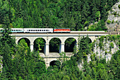 Train passing Kalte Rinn viaduct, Semmering railway, UNESCO World Heritage Site Semmering railway, Lower Austria, Austria