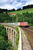 Train passing Wagnergraben-viaduct, Semmering railway, UNESCO World Heritage Site Semmering railway, Lower Austria, Austria