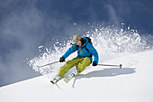 Skier in deep powder snow, Disentis, Oberalp pass, Canton of Grisons, Switzerland