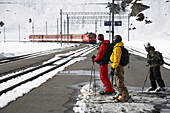 Skier waiting for a train, Disentis, Oberalp pass, Canton of Grisons, Switzerland