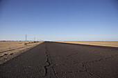 Empty asphalt road in the desert, Birak, Lybia, Africa
