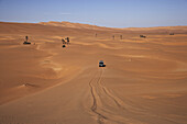 Toyota Landcruiser in lane in the dunes, Lybia, Africa