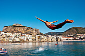 Man jumping in the sea, Cefalú, Palermo, Sicily, Italy