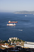 Freighter and tanker beinng in the roads in a bay, Gibraltar, Europe