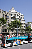 City sightseeing bus in front of building by Antoni Gaudi, Barcelona, Catalonia, Spain, Europe