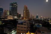 Full moon over Sathorn business area, Bangkok, Thailand