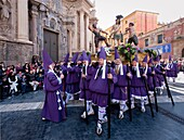 Good Friday procession with float by Baroque sculptor Francisco Salzillo passing by cathedral, Murcia, Spain