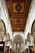 D-Neumuenster, Schleswig-Holstein, church Saint Vicelin, catholic church, neo-Gothic style, interior view, choir, altar, wooden coffered ceiling