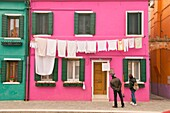 coloured houses, with washing hanging, on the island of Burano Venice Italy