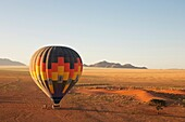 Namibia - The hot-air balloon shortly before take-off in the light of the early morning Namib Desert, NamibRand Nature Reserve, Namibia