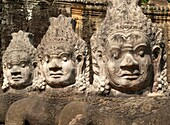 Cambodia - Row of demons along the access road to the South Gate of Angkor Thom, theGreat Capital,  of the Khmer empire in Angkor The temple complexes of Angkorcity,  were the heart of the Khmer empire which flourished from the 9th to the 13th century