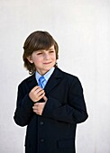 blue eyes, boy, brown hair, Caucasian ethnicity, chestnut hair, child, childhood, clipping path, Color image, contemporary, dressed up, elegance, elegant, gesture, human, infancy, kid, Male, necktie, one, one person, people, pre-teen, smile, stand, standi