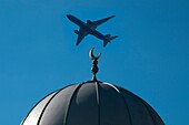 Europe, UK, England, London, Hounslow mosque, airliner overhead