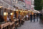Latvia, Riga, Vecriga, Old Riga, Livu Laukums Square cafes, dusk
