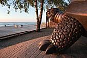 Latvia, Western Latvia, Riga Area, Jurmala, Majori Village, Majori Beach turtle statue, sunset