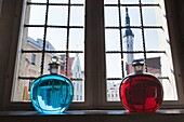Estonia, Tallinn, Old Town, Raekoja Plats, Town Hall Square, Town Council Pharmacy, b 1422, colored liquid in window overlooking town hall