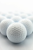 Many golf balls in a still life arrangement