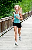 30 year old blonde woman jogging in work out clothes