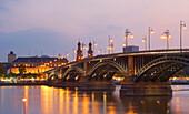View over river Rhine with Theodor Heuss Bridge to Deutschhaus and St. Peter's church in the evening, Mainz, Rheinhessen, Rhineland-Palatinate, Germany