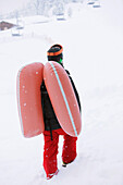 Male free skier with inflated avalanche airbag, Mayrhofen, Ziller river valley, Tyrol, Austria