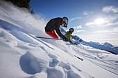 Skiers downhill skiing at Blackcomb Peak, British Columbia, Canada