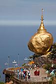 Buddhistic pilgrim destination Kyaikhtiyo Pagoda with the golden rock, Mon State, Myanmar, Birma, Asia