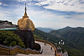 The Golden Rock, Buddhistic pilgrim destination Kyaikhtiyo Pagoda under clouded sky, Mon State, Myanmar, Birma, Asia